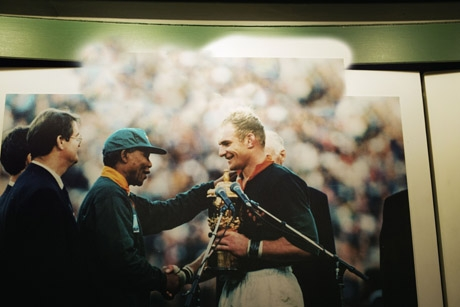 A moment when rugby, politics,and history converged: Nelson Mandela hands François Pienaar the 1995 World Cup after South Africa defeated New Zealand in extra time.